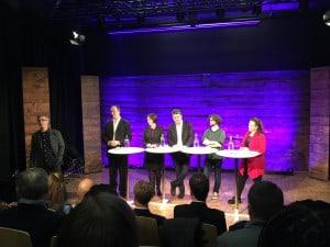 Panelet og publikum var i godt humør etter at regjeringen har lovet 33 mrd. til ny vei og bane Arna-Voss.  Foto: Harald V Hove
